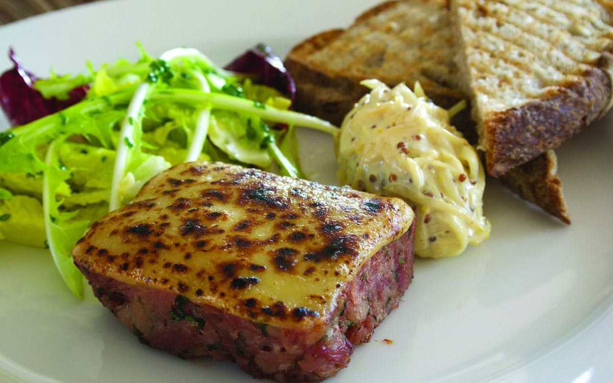 Colliers Cheese Collier's Welsh Rarebit on Ham Hock with Celeriac Remoulade and Rocket
